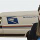 Worried woman with mail truck